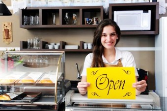 business woman holding open sign